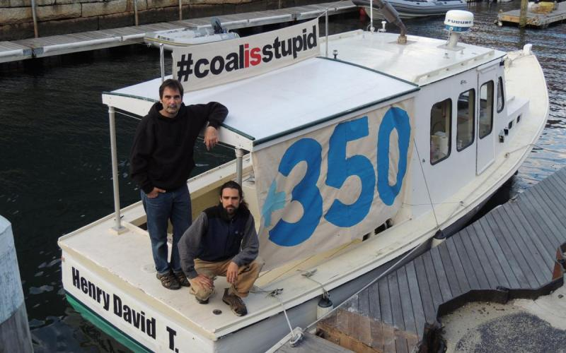 Environmental activists aboard the Henry David T., a refitted lobster boat they used to block the tanker Energy Enterprise from delivering coal to the Brayton Point power generating plant to try to limit the Somerset facility's output of greenhouse gases.