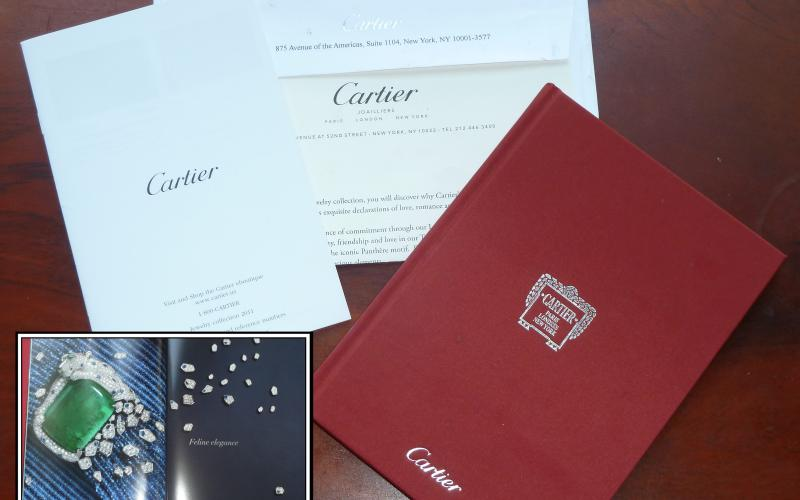 Picture of a direct mail piece from the Cartier. High gloss pictures, in a bounded book form and ready for the trash can. Terrible!